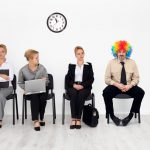 There's one in every crowd - clown among job candidates waiting